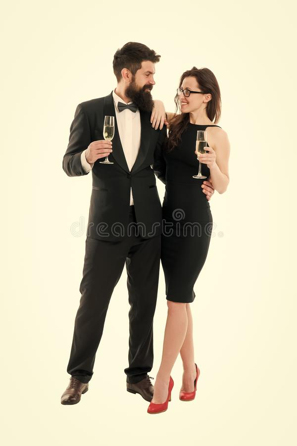 Cheers. Toasting to success. formal sexy woman bearded man. Event celebrate. Love date. happy romantic couple in love royalty free stock image