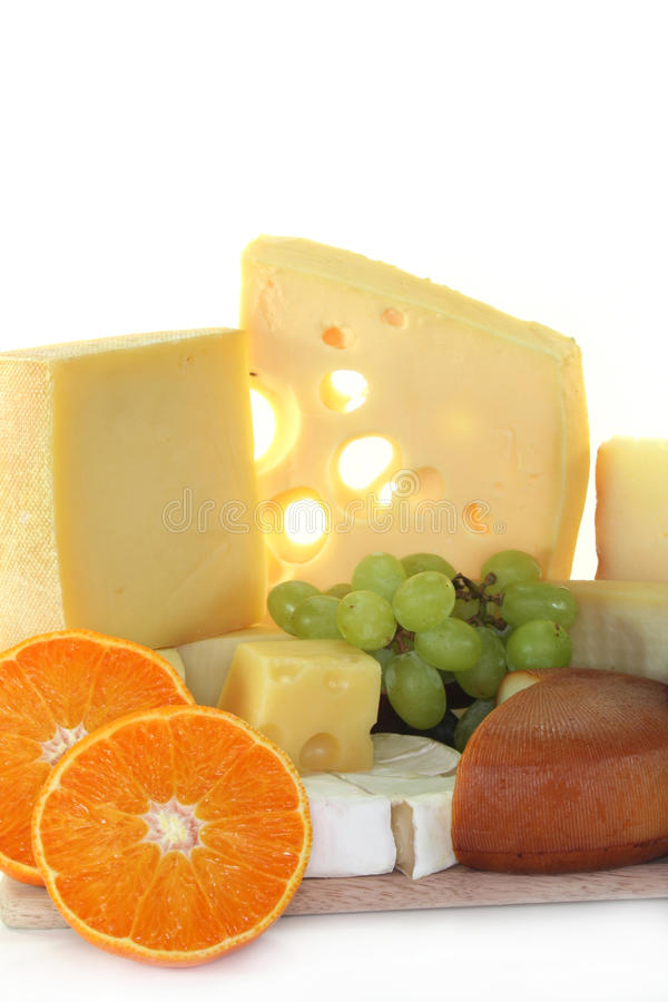 Cheese. Different varieties of cheese with fresh bright and dark grapes stock photo
