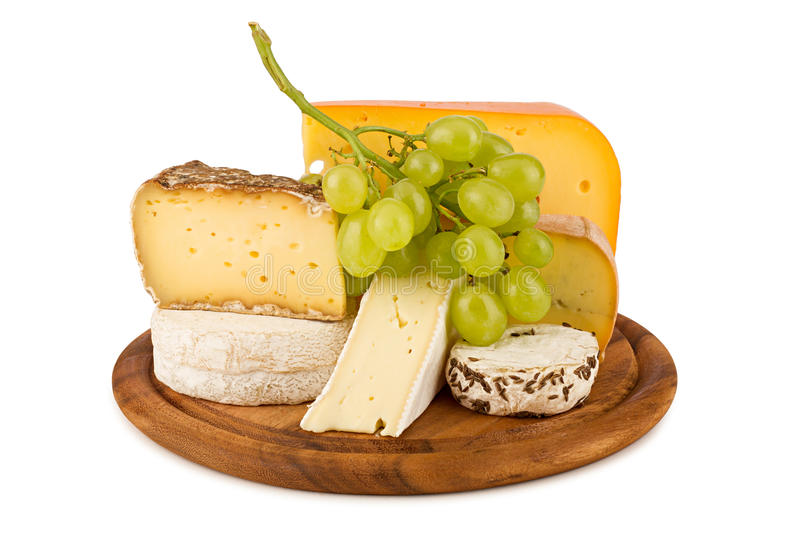 Cheese. Board with cheeses and white wine grapes stock photo