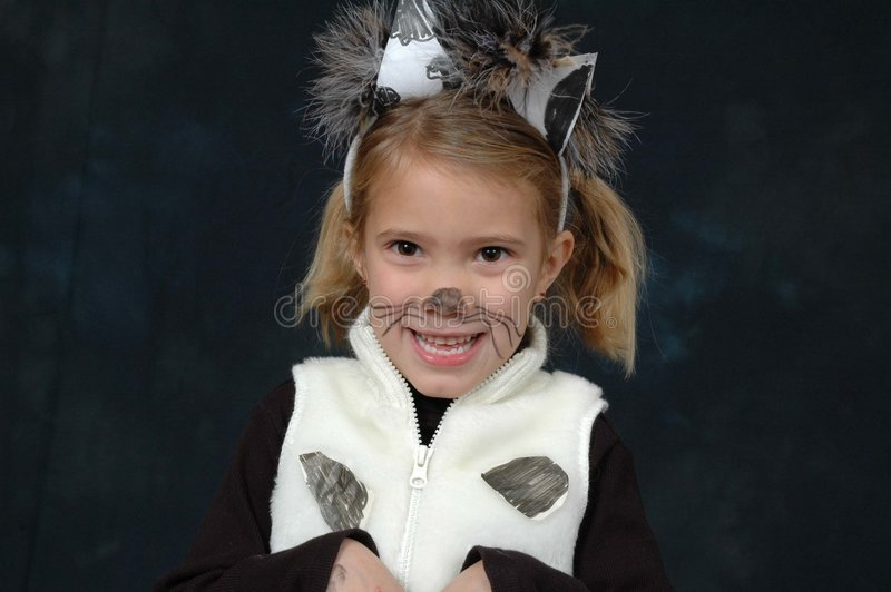 Cheese!. Child dressed up like dalmation dog. Beautiful Young blonde model stock photo