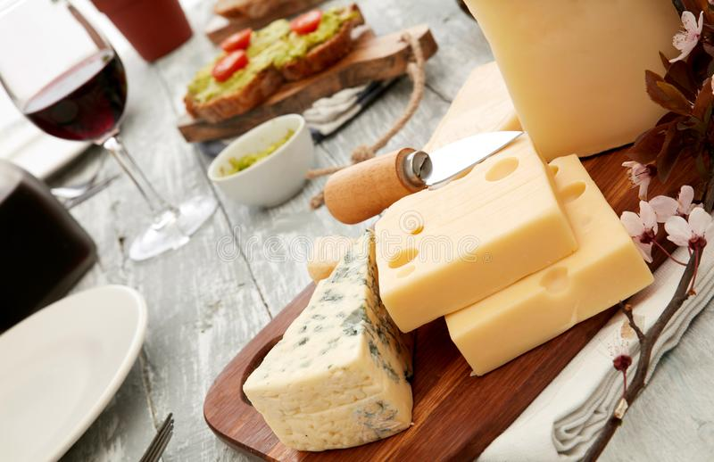 Cheese assortments on cutting board royalty free stock photo