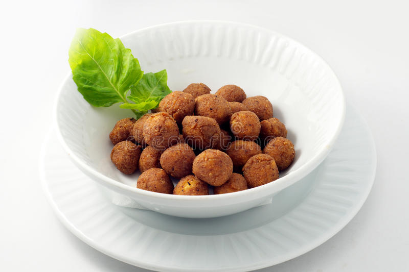 Cheese balls, breaded. On the white plate with white background stock image
