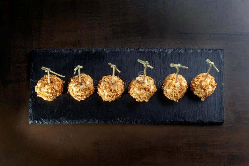 Cheese balls in breading, with natural bamboo skewers. Top view stock images