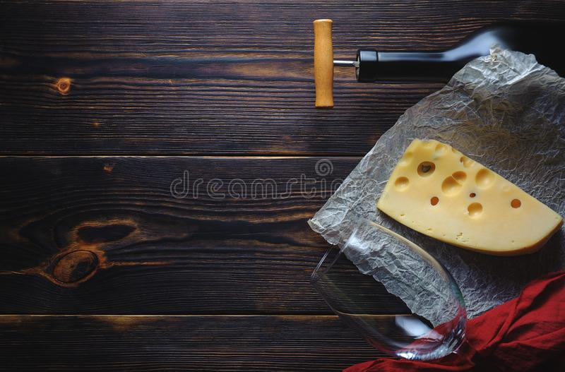 Cheese bottle of wine and a glass. Copy space royalty free stock photography
