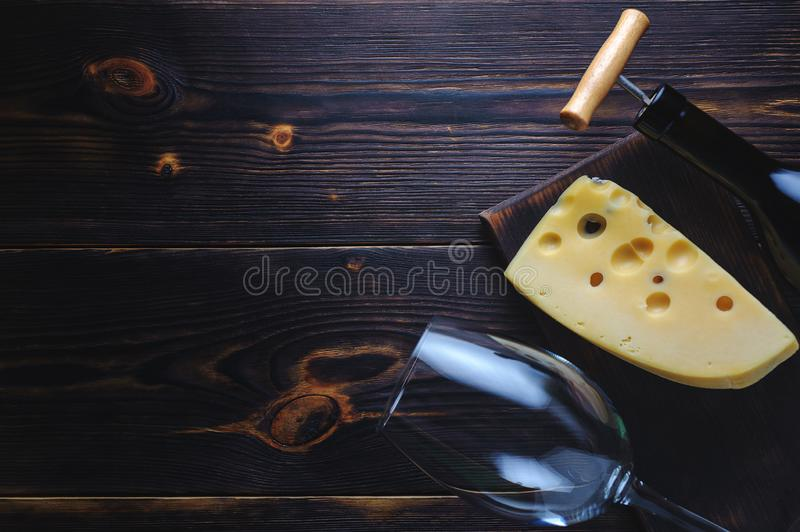 Cheese bottle of wine and a glass. Copy space stock photography