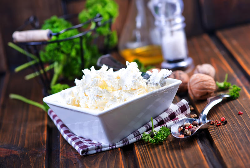 Cheese. In bowl and on a table royalty free stock photo