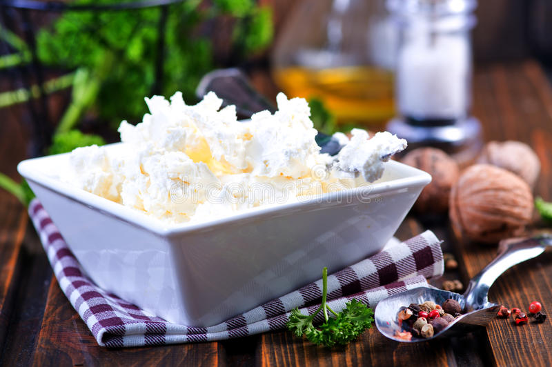 Cheese. In bowl and on a table stock images