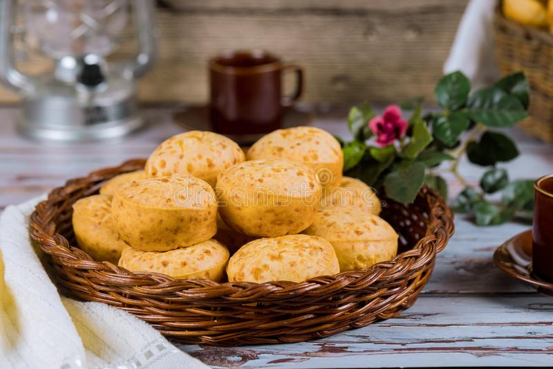 Cheese bread, chipa with coffee and flowers. Cheese bread, brazilian chipa with coffee and flowers, yuca, argentina, tapioca, paraguay, food, baked, bun, lunch stock photo