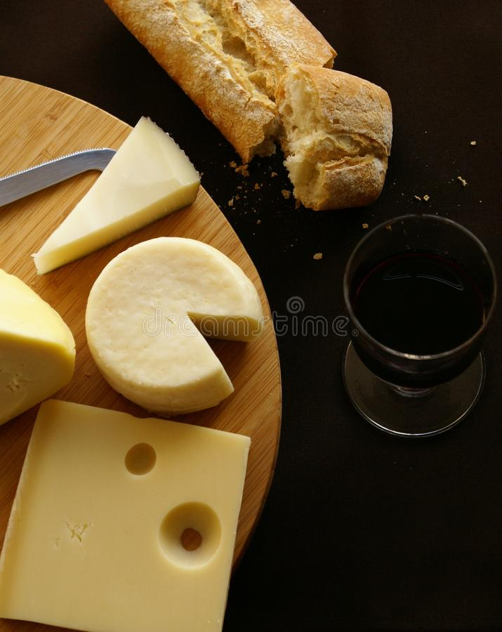 Cheese, bread and red wine royalty free stock image