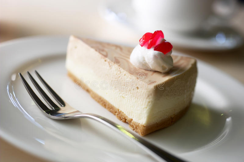 Cheese cake. And a cup of cappuccino stock photos