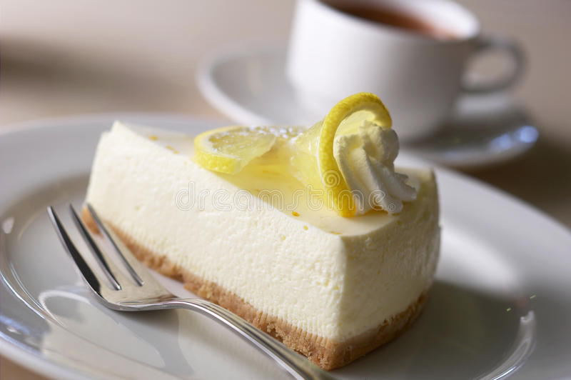 Cheese cake. And a cup of cappuccino stock images