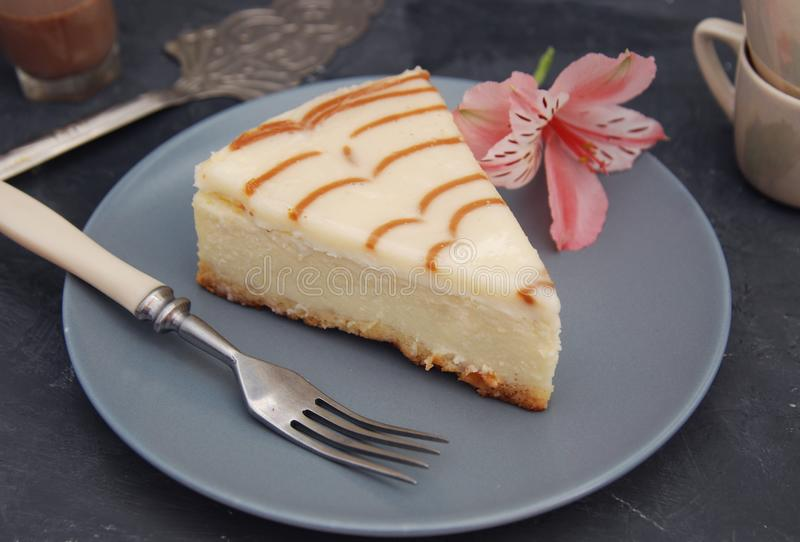 Cheese Cake with Caramel Sauce Isolated Caramel Sauce over Brown Paper with Spoon Sweet Sugar Dessert. Cheese Cake with Caramel Sauce Isolated Caramel Sauce over royalty free stock image