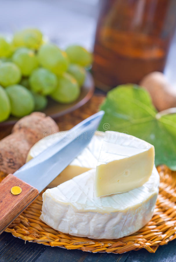 Cheese. Camembert and grape on a table stock photography