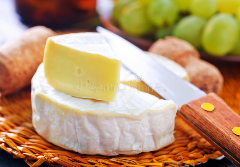 Cheese. Camembert cheese, cheese on the wooden table stock image