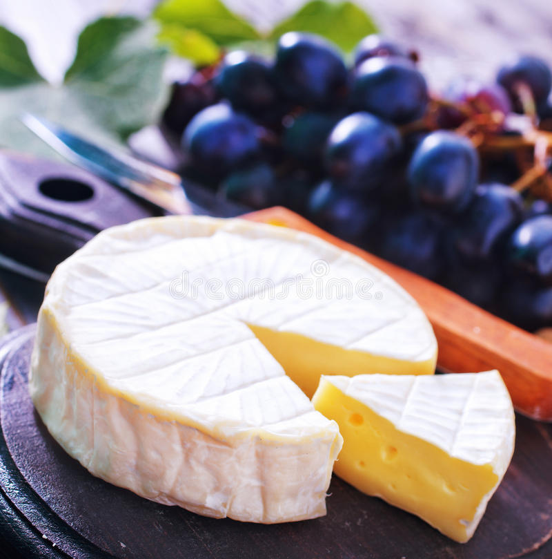 Cheese. Camembert cheese, cheese on the wooden table stock photo