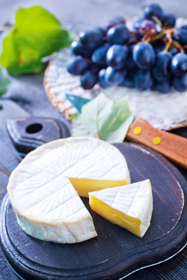 Cheese. Camembert cheese, cheese on the wooden table stock photography
