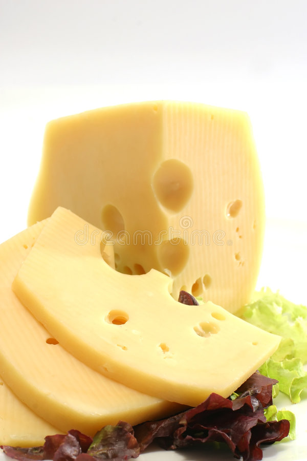 Cheese chunk and slices with lettuce. Over white royalty free stock photography