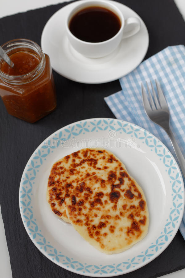 Cheese, cloudberry jam, and coffee royalty free stock photos