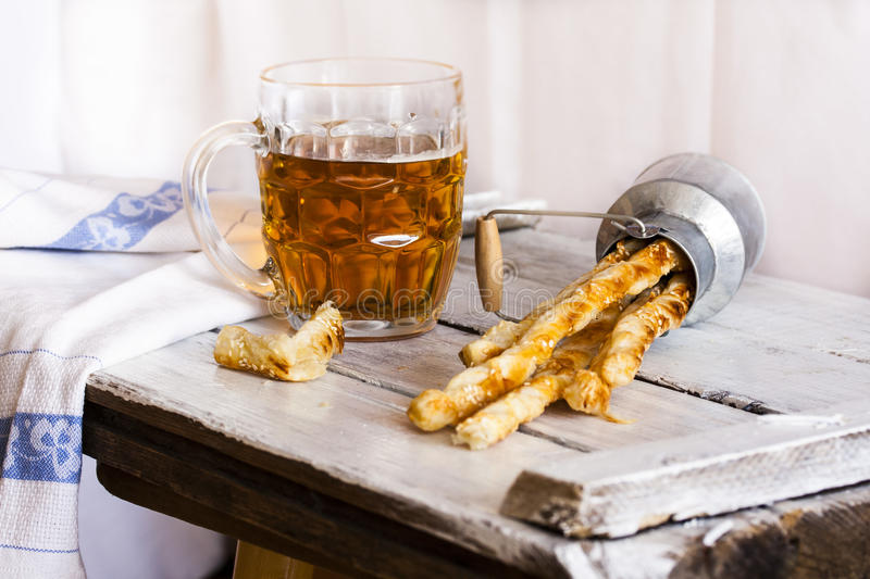 Cheese crackers made of puff pastry with sesame seeds stock photo