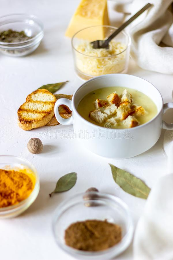 Cheese cream soup on a white background. White bread croutons. Ingredients. Food meal dinner hot creamy fresh gourmet healthy homemade lunch tasty dish stock image