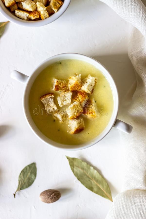 Cheese cream soup on a white background. White bread croutons. Ingredients. Food meal dinner hot creamy fresh gourmet healthy homemade lunch tasty dish stock photo