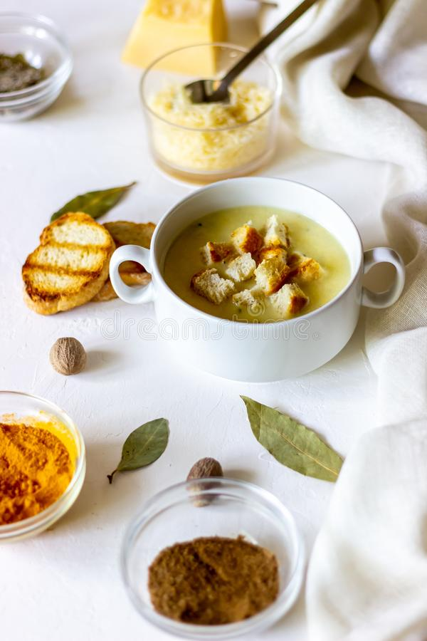 Cheese cream soup on a white background. White bread croutons. Ingredients. Food meal dinner hot creamy fresh gourmet healthy homemade lunch tasty dish royalty free stock images