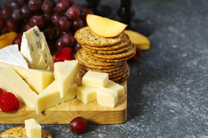 Cheese, crackers and fruits. royalty free stock images