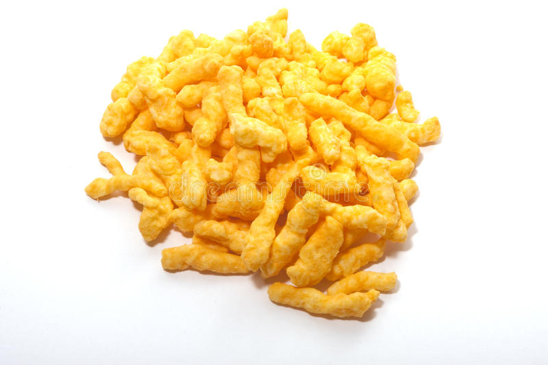 Cheese curls. Pile of cheese curls on white background stock photo