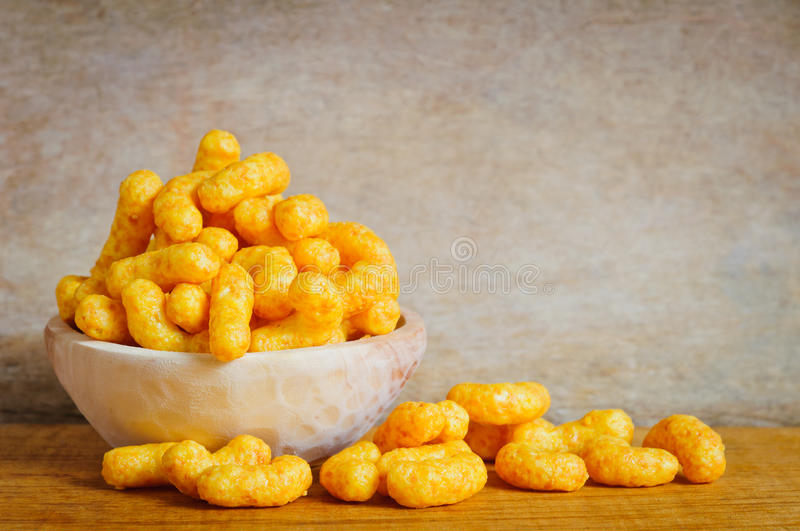 Cheese curls. Bowl with cheese curls snacks stock photography