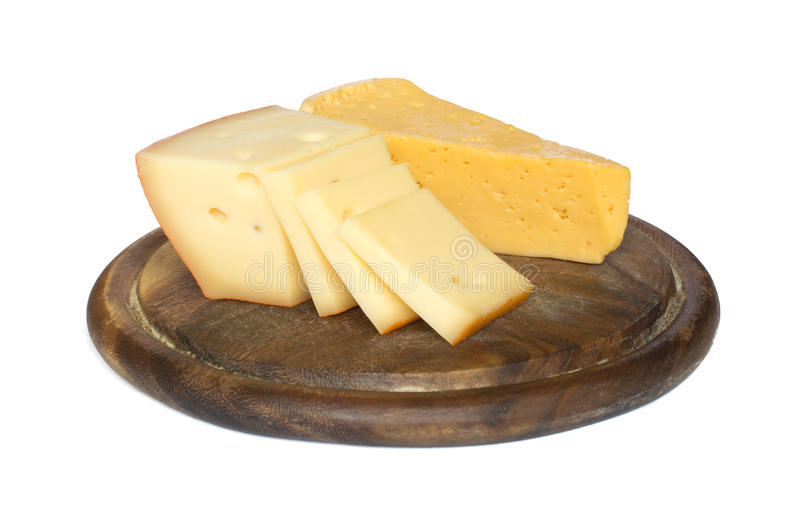 Cheese on a cutting board royalty free stock images