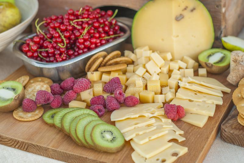 Cheese and fruits on a beautifully vintage decorated table. Outdoor wedding reception royalty free stock photos