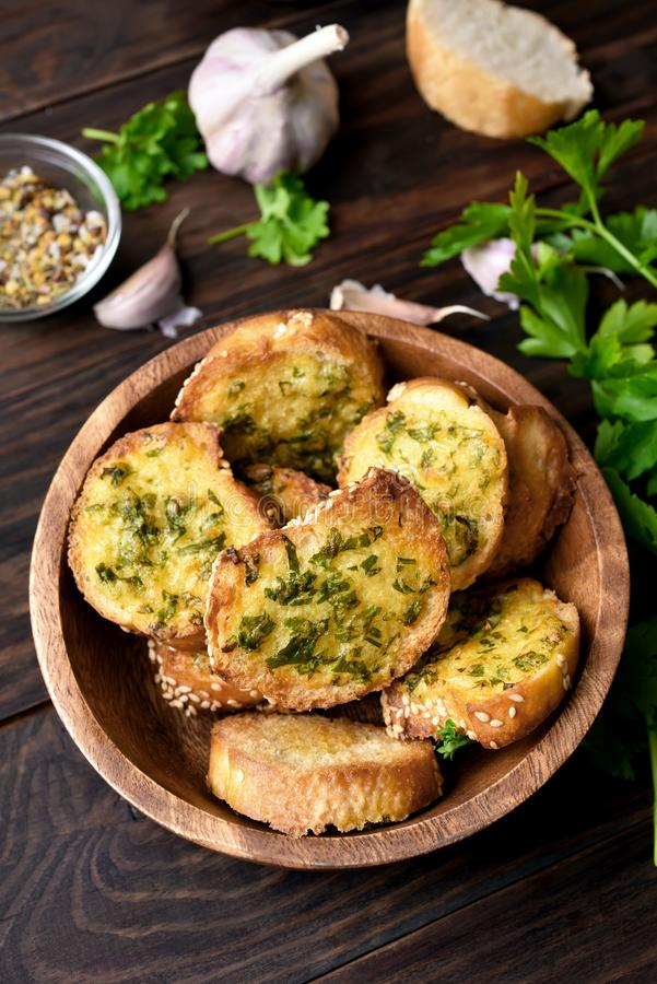Cheese garlic toasts. In bowl over wooden background stock images