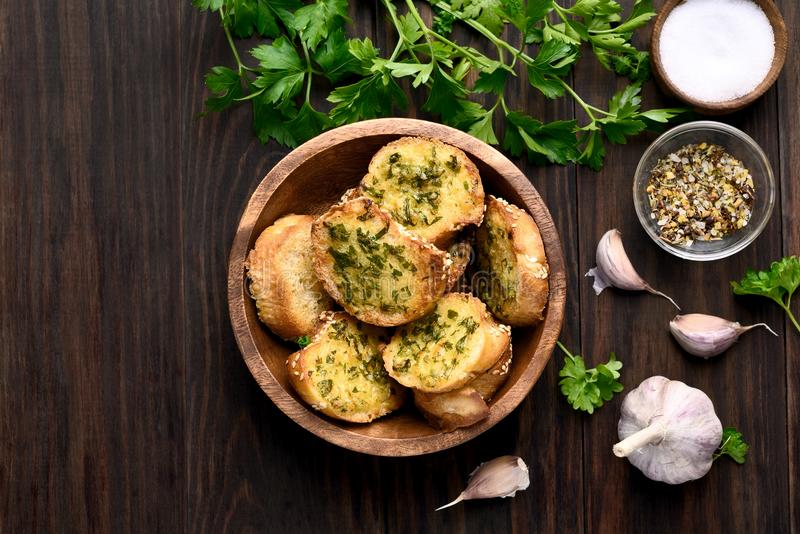 Cheese garlic toasts. In bowl over wooden background with copy space, top view royalty free stock photography
