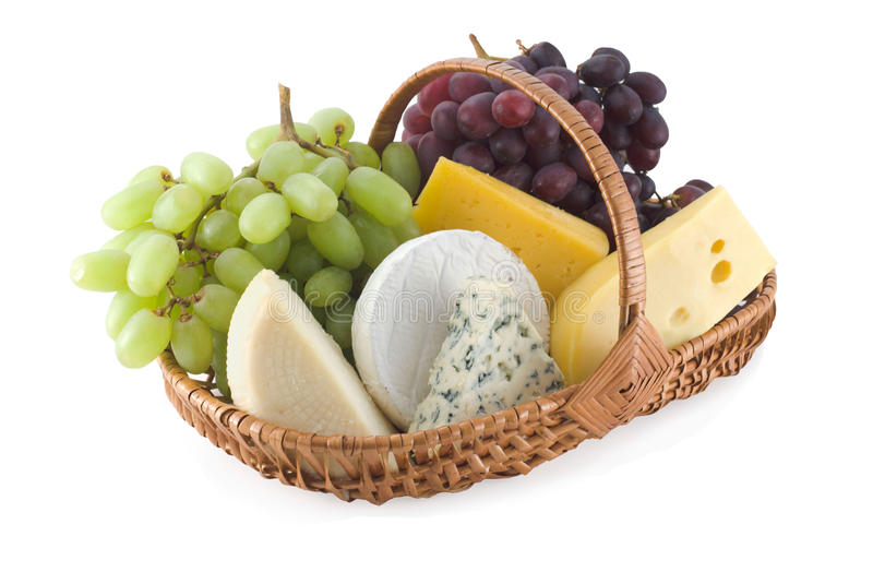 Cheese and grapes in a basket royalty free stock photo