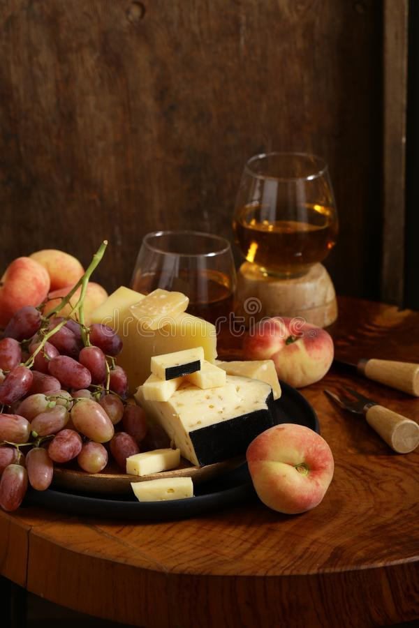 Cheese, grapes and wine stock image