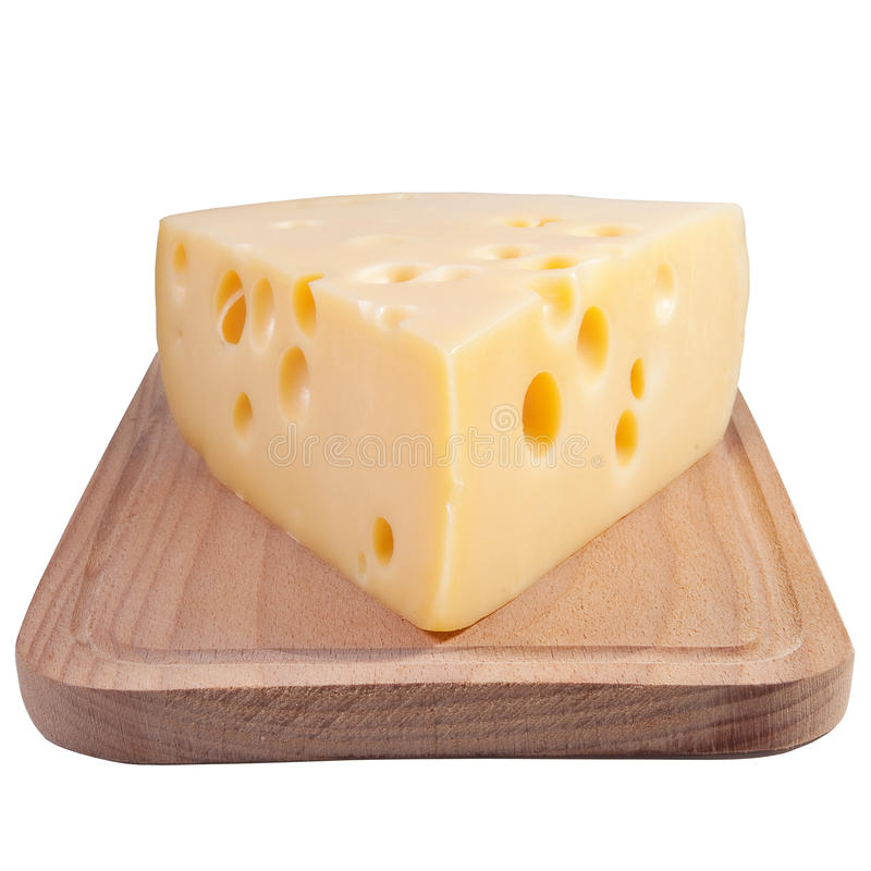 Cheese on a grunge wooden board royalty free stock photos