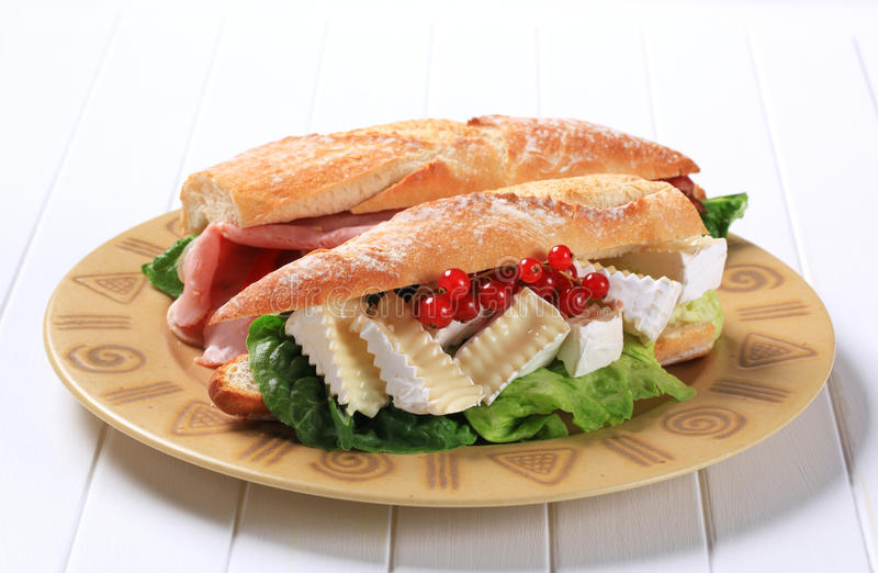 Cheese and ham sub sandwiches. Sub sandwiches with cheese and ham stock images