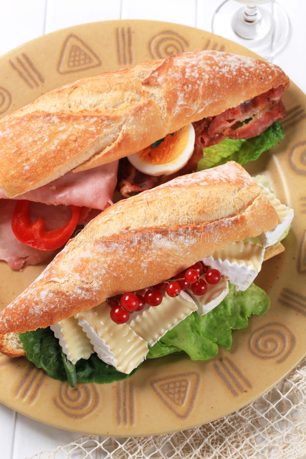 Cheese and ham sub sandwiches. Sub sandwiches with cheese and ham stock image