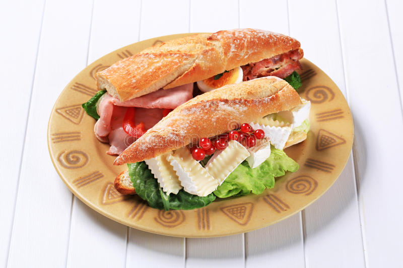 Cheese and ham sub sandwiches. Sub sandwiches with cheese and ham royalty free stock photos