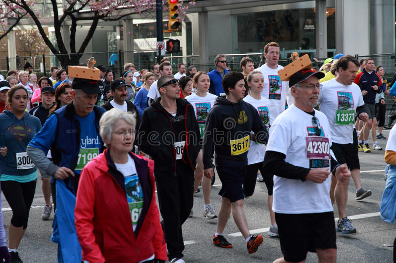 Cheese Head Racers At  2013 Vancouver Sun Run Editorial Image