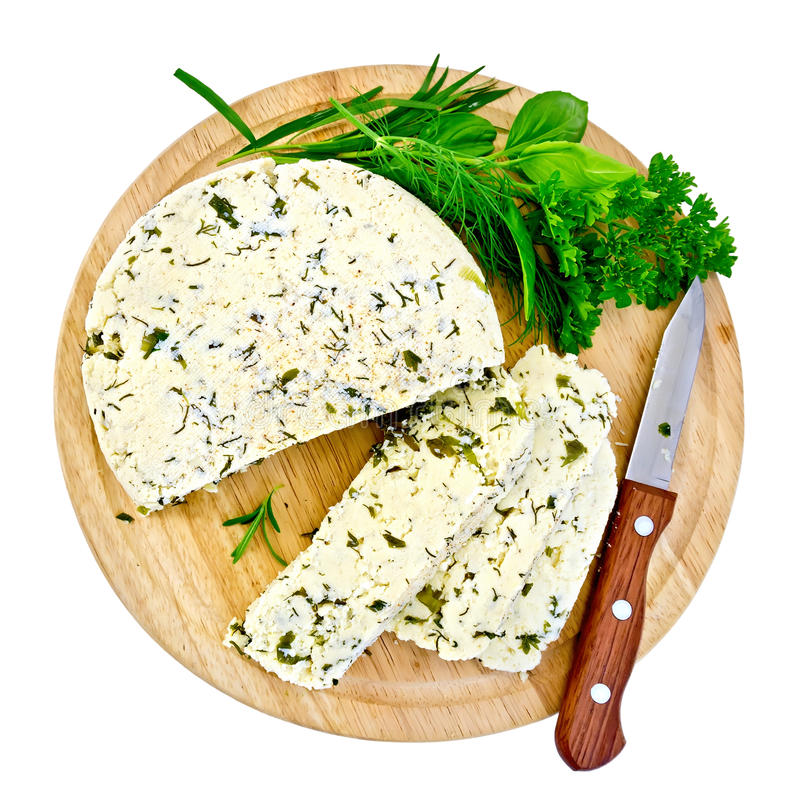 Cheese homemade with herbs on round board royalty free stock image