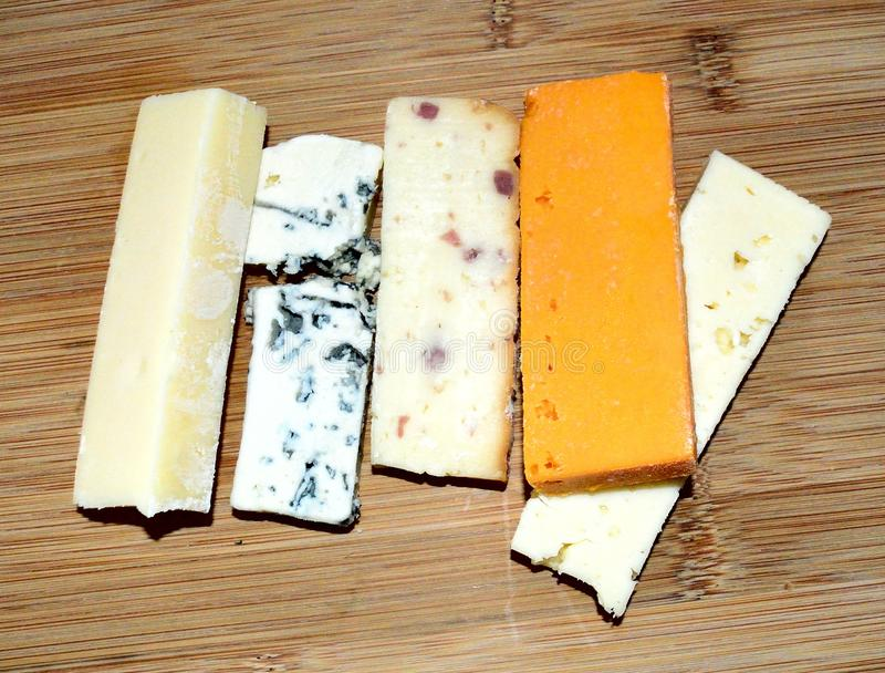Cheese. Ingredients, piece. Cheese Collection. Cheese laying on a board stock photos
