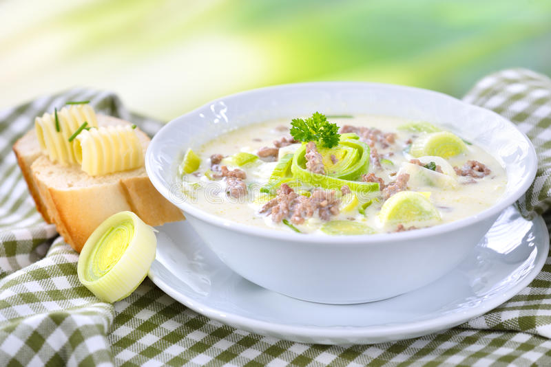 Cheese and leek soup with meat stock photos