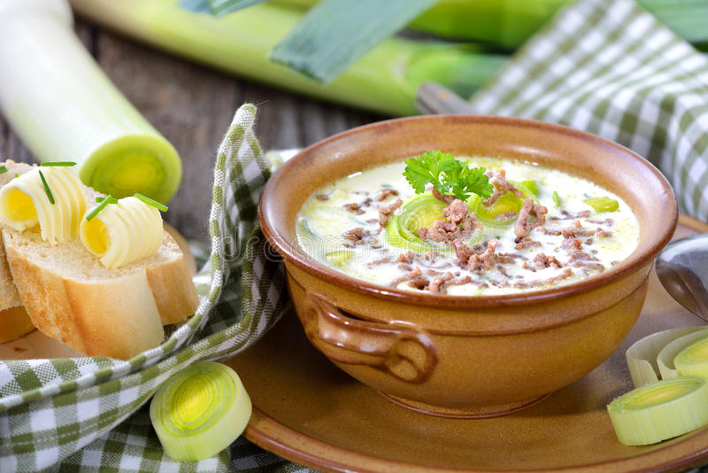 Cheese and leek soup with meat stock images