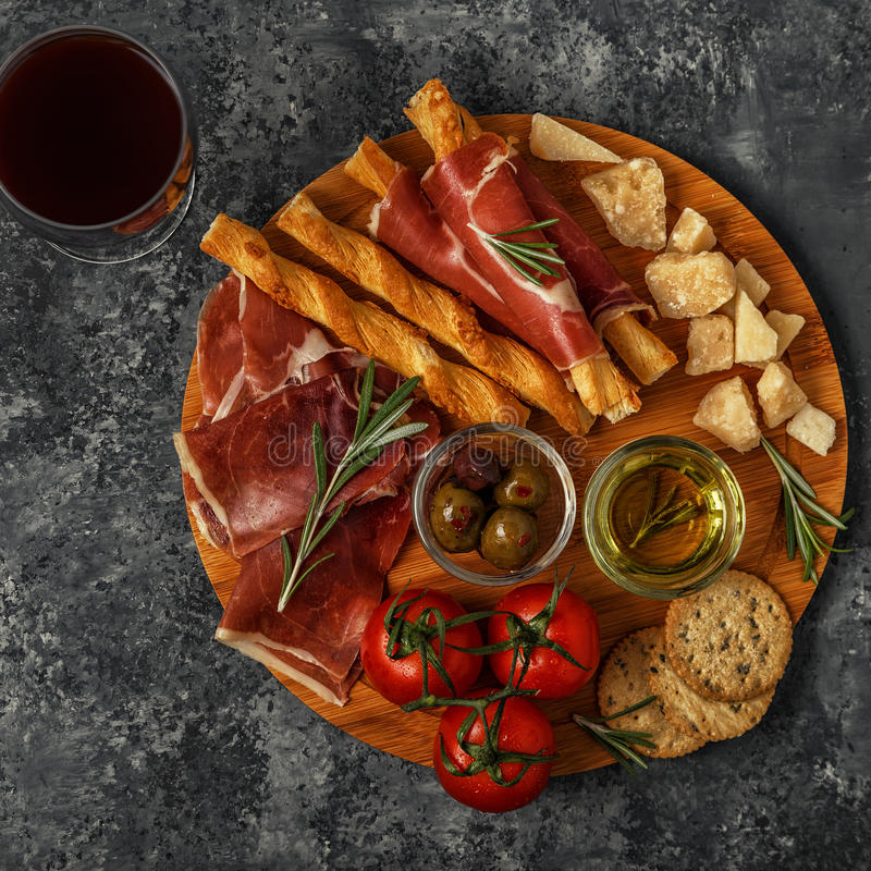 Cheese and meat appetizer selection, top view. stock images