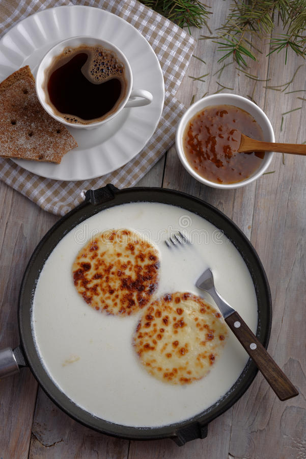 Cheese in milk, cloudberry jam, and coffee royalty free stock photo