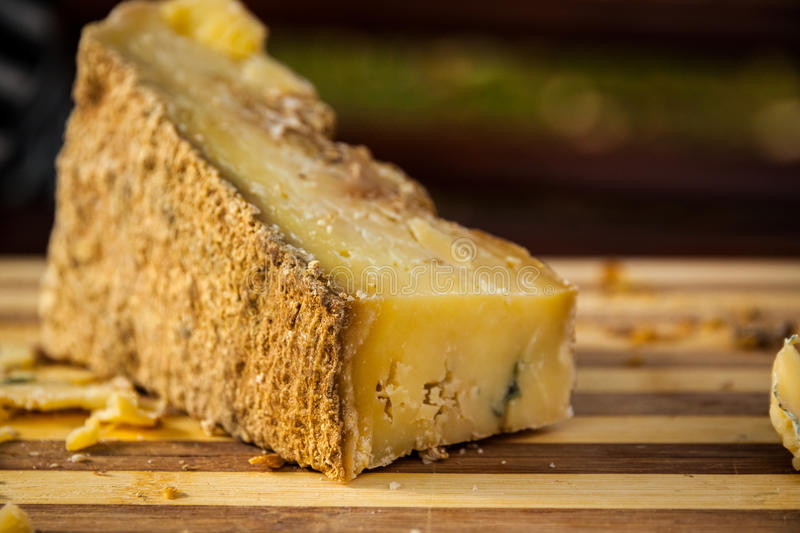 Cheese with mold. Bulgarian cheese with mold on a wooden board royalty free stock images