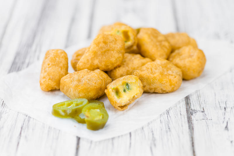 Cheese Nuggets with Chilis selective focus, close-up shot stock image