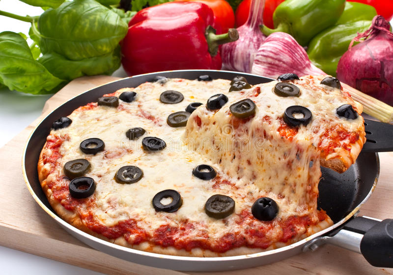 Cheese and olive pizza, one slice lifted up stock photos