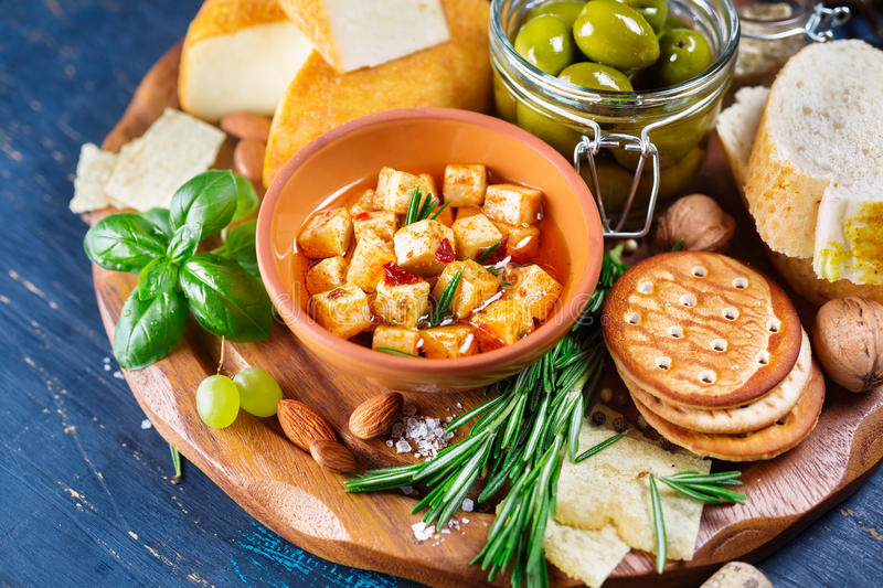Cheese with olives and green herbs royalty free stock photo